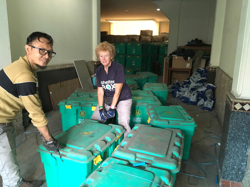 ShelterBox Response Team members sorting aid in Indonesia
