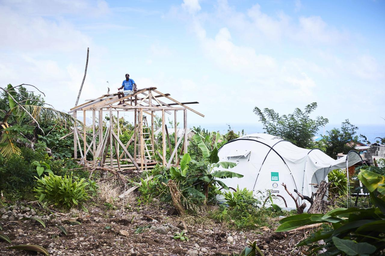 In the small island of Barbuda, we supported over 200 households. Here, a local is already in the process of repairing his home.