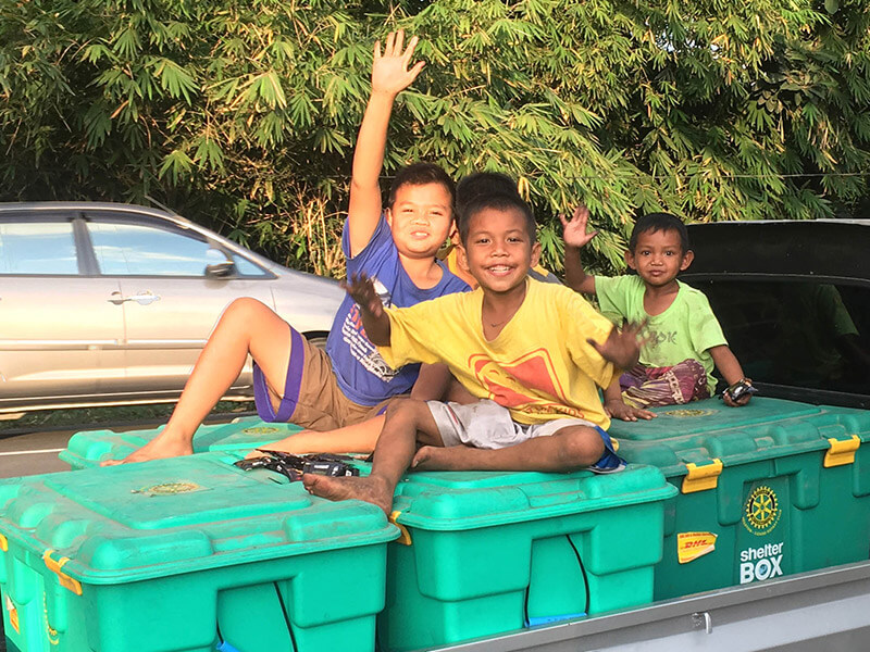 Kids sitting on ShelterBoxes in Lombok
