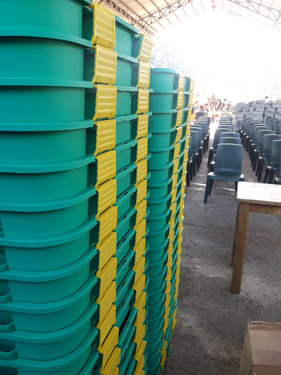 Stacked ShelterBoxes with aid items separated take up 30% less space